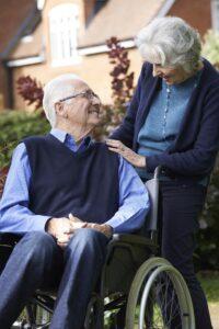 Elderly Couple Using Wheelchair